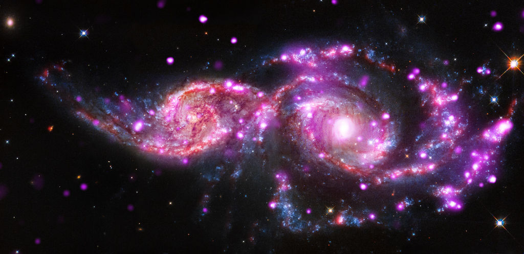 Chandra, Hubble and Spitzer telescopes capture  NGC 2207 and IC 2163 in a wicked lightshow