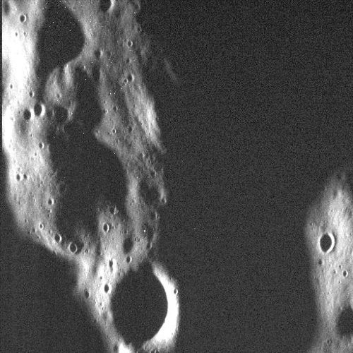 Some see a scary ghost face where other see mountains and craters from Mercury