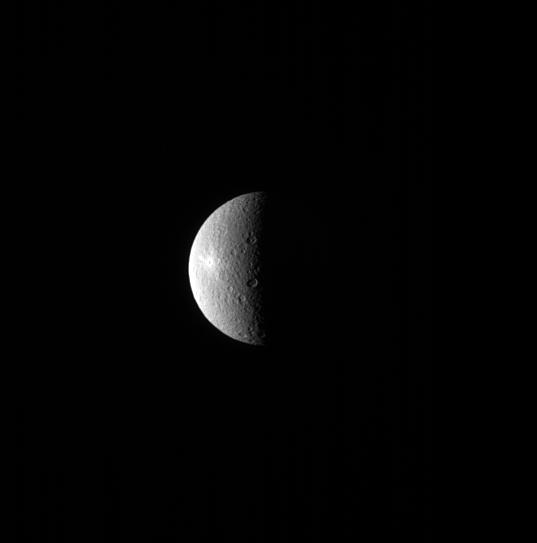 The bright spot on Rhea is the Inktomi crater, named after a Lakota spirit