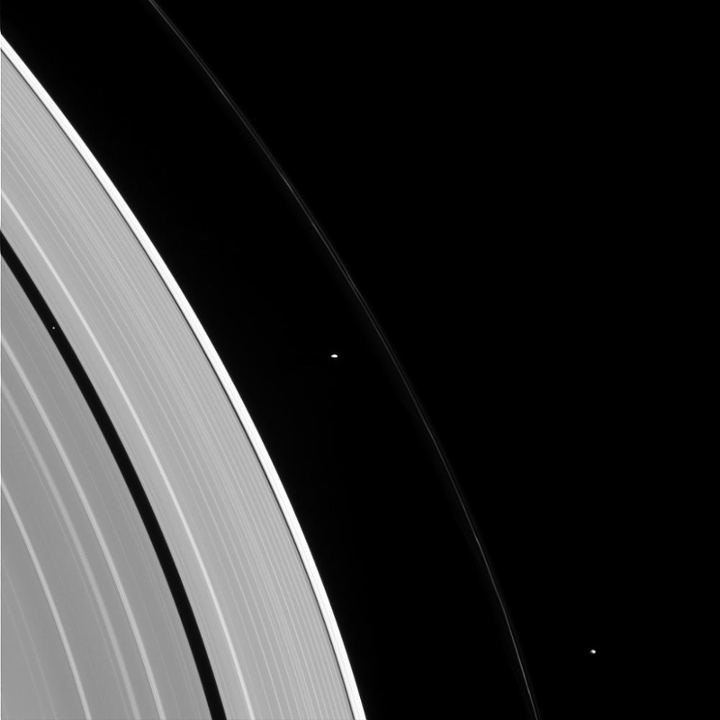 Cassini photographed three of Saturn's moons and its rings
