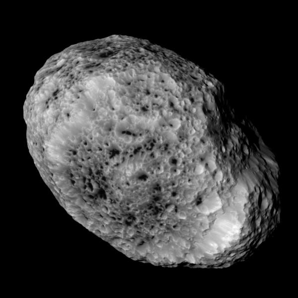 Cassini takes this picture of Hyperion as it leaves it behind