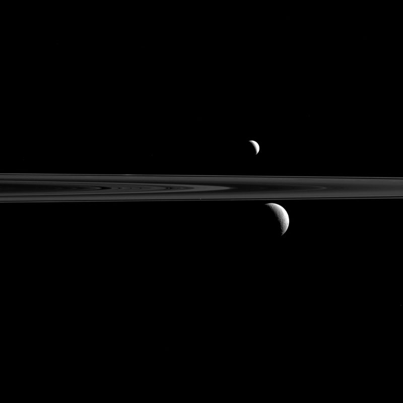 Enceladus and Rhea with Saturn's S rings in between